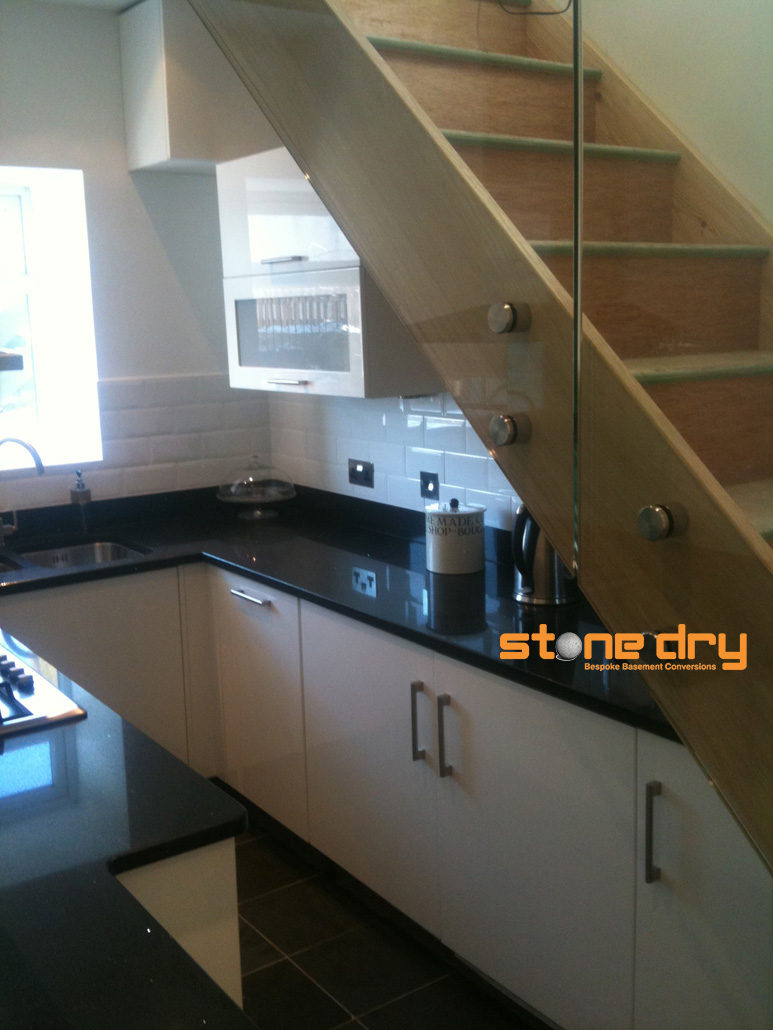 Modern Kitchen And Stairs Basement Conversion Stone Dry