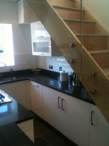 Modern Kitchen with glass staircase
